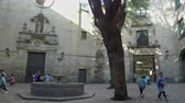 recessão : Ancient Barcelona, ??Gothic Quarter.Panoramic view of the St. Felip Neri square, with students playing at recess. Smooth camera movement: panning left.