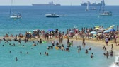 уборная : Activity on the beaches of the city of Barcelona a sunny summer day, with traffic nautical background. Time lapse.Tilt-shift effect.4k.
