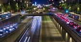 long exposure : Cinemagraph of night scene urban, underground traffic in motion and static traffic surface.Time Lapse - Trail effect - Long exposure - 4K. Fixed plane