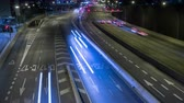 main line : Scene of traffic at dusk in a main street of entry and exit of Barcelona. Top view.Long exposure. Time Lapse.Trail effect.Logos, car registrations, etc. are blurred blurred frame by frame. Stock Footage
