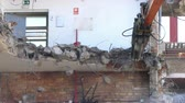 takviye edilmiş : Close-up of heavy demolition machinery at work, cutting of reinforced concrete. Stok Video