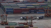 good time : Activity in the container terminal.Time Lapse. Maneuvers loading and unloading of several trucks at the container terminal at the port of Barcelona.