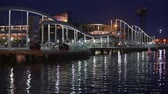 port of barcelona : Night view of Rambla de Mar, footbridge modern design in the port of Barcelona, ??a must for visitors to walk into town.