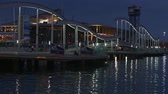 уборная : Night view of Rambla de Mar, footbridge modern design in the port of Barcelona, ???? a must for visitors to walk into town.Time Lapse. Стоковые видеозаписи
