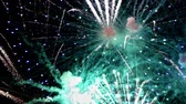 Detail of fireworks, Large explosions in green and blue colors.slow motion