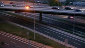 Road traffic scene in the dusk, with bridge in side view, and cars moving in different directions and levels, of entry and exit of Barcelona. Stock Footage