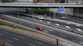 Road traffic scene in the Afternoon, with bridge in side view, and cars moving in different directions and levels, of entry and exit of Barcelona. Stock Footage