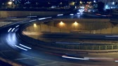 Cinemagraph of roundabout above highway. Night scene urban traffic, of Barcelona, ??underground traffic in motion and static traffic surface.Time Lapse - Trail effect - Long exposure - Fixed plane.