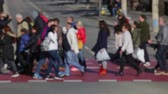 Side view blurry pedestrians crossing the street in the city of Barcelona. (09)
