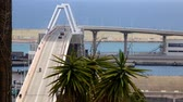 port of barcelona : Concrete bridge over the port of Barcelona with maritime and road traffic.Time Lapse Stock Footage