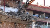 quebra : Close-up of heavy demolition machinery at work, pushing debris. Slow Motion