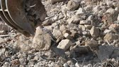 demolida : Close-up of heavy demolition machinery at work, crumbling and moving rubble concrete. Slow Motion Stock Footage
