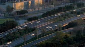 카탈 루나 : Traffic scene and road at sunset. Long Exposure.Time Lapse Road traffic of entry and exit of Barcelona traversing the frame diagonally. Aerial view.