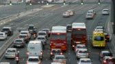main line : Blurred evening urban traffic scene with a top and rear view access roads to Barcelona, with the cars stopped at the semaphore and an ambulance asking for passage. Stock Footage