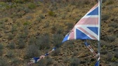 reino unido : Old, broken and discolored flag of the United Kingdom moved by the wind