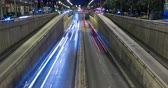 Night scene urban traffic, top and front view of Barcelona.Time Lapse - Trail effect - Long exposure - 4K. Fixed plane.