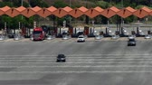 Scene of traffic in motion in a toll of C-32 freeway in Arenys de mar, province of Barcelona. Time Lapse. Top and front view.