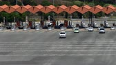 Scene of traffic in motion in a toll of C-32 freeway in Arenys de mar, province of Barcelona. Top view. Top and front view.
