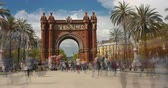 Touristic Barcelona, Arc de Triumph. Time Lapse.Long exposure.Silk effect. Panoramic view of Arch of Triumph with crowd of unrecognizable people (semitransparent) walking.Camera movement: Pannig Right.