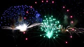 Many multicolored explosions with multicolored circles and large pyrotechnic rockets. slow motion