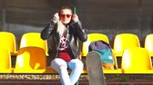 Girl skater basking in the sun. Autumn shooting. Stock Footage