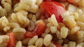 kafeterya : Pearl barley with cherry tomatoes and first salt Stok Video