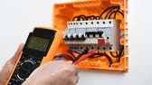 An electrician technician with a multimeter. Construction industry.