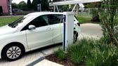 electro mobility : electric car being charged
