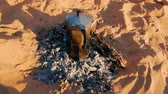 italian coffee machine on embers in the Sahara desert Stock Footage