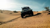 driving off-road car in the sahara desert