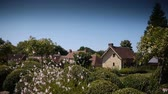 konzervace : Garden with houses and flowers in Normandy, France