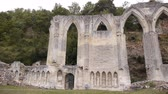 harabeler : Ruined exterior of priory or Beaumont le Roger, Normandy France, PAN Stok Video