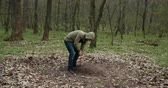 プロテスタント : The Guy Sets A Homemade Cross On The Grave Of A Dead Pet. Dog Funeral, Grave With A Cross. Close Up. Prores, Slow Motion 動画素材