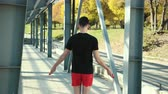 jezera : Young Athlete Man In Comfortable Sport Outfit Jumping Rope On Sports Field On Platform Near Metal Racks. Boy Doing Jump Rope Workout On Stadium Background. Fitness Male Doing Skipping Workout Outdoors