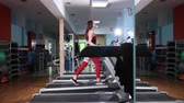 retener : Beautiful Sexy woman are running on machine in gym,Doing cardio training on treadmill,Exercise cardio running workout at fitness gym with machine aerobic for slim and firm healthy. Prores, Slow Motion
