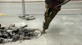 прерыватель : Close-up of hydraulic arm hammer breaks the asphalt on the road. Prores, slow motion
