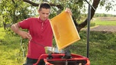 pente : beekeeper cuts wax from honeycomb frame with a special electrik knife Stock Footage