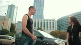 autohändler : young man greets and gives the car keys to brunette girl with long hair Videos
