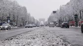 The arc de triumph by a rare snowy day in Paris, France