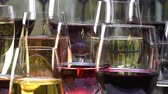 Champagne, white, rose and red wine and drinks in glasses on stained glass background, France