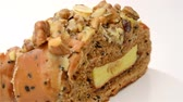 bakery : healthy and yummy bread with walnut raisin and melon seed rotating on white