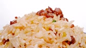 пауза : fried rice with beef on a bowl rotate and pause close up