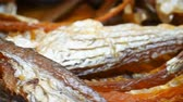 высушенный : side view dry salty fishes turning and pause