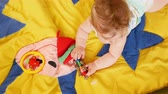 tot : Seven month old baby Playing on colored carpet. Stock Footage