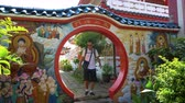 Caucasian man entering round doorway in Chinese temple