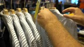 Male customer choosing office shirt at shopping mall