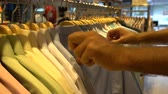 szafy : Male customer choosing office shirt at shopping mall