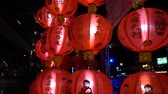 domorodý : Glowing Red Chinese lanterns at night, slow motion