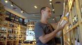 Man is shopping at wine store