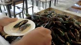 Caucasian man take mussels at Thai traditional buffet